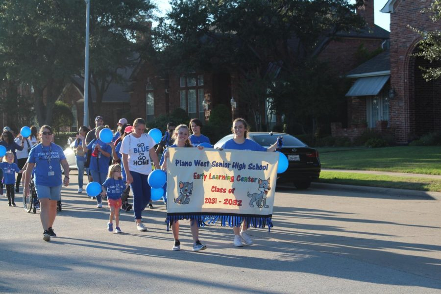 Educators in the Early Learning Center march in the parade.