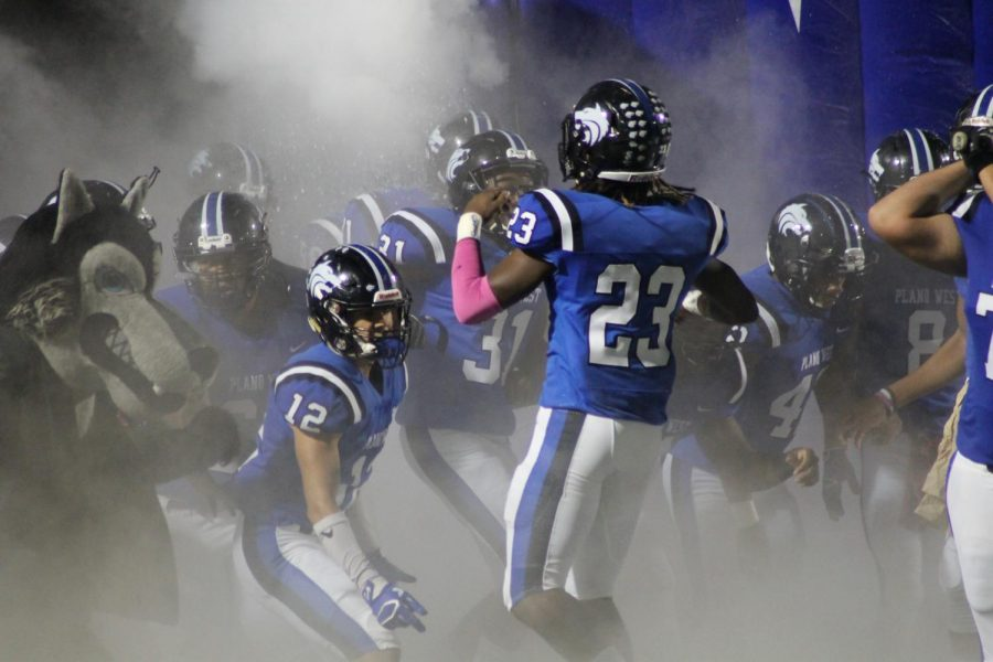 Wolves%27+linebacker+Jared+Brumfield+%28%2323%29+leads+Plano+West+out+of+the+tunnel+against+McKinney+on+Friday.