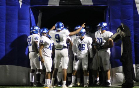 Plano West WR Tavarius Garland (#9) hypes the team up in the tunnel before a game against Plano Senior.