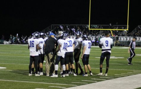 Plano West Head Coach Scott Smith talks with the offense in a huddle in last week's game against Prosper.