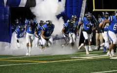 Plano West running out of the tunnel last Friday against Plano East.