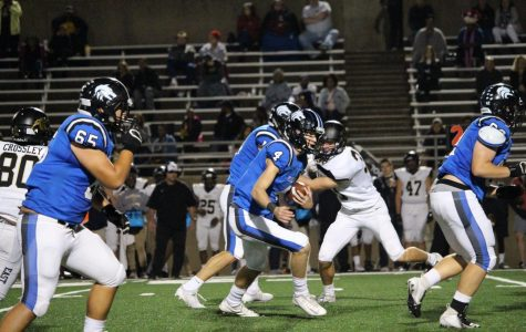 Plano West QB Will Cannon (#4) looks to pick up a few yards on a rush. Cannon threw for 117 yards against Plano East.
