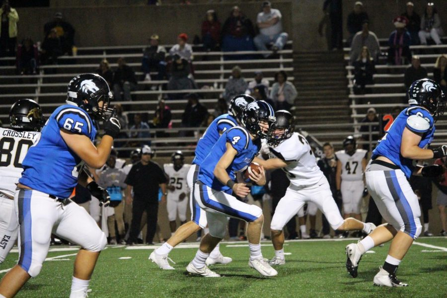 Plano+West+QB+Will+Cannon+%28%234%29+looks+to+pick+up+a+few+yards+on+a+rush.+Cannon+threw+for+117+yards+against+Plano+East.