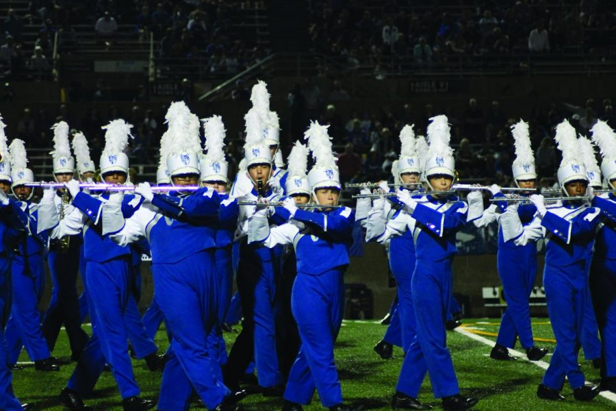West Band takes the football field during the Homecoming game to play.