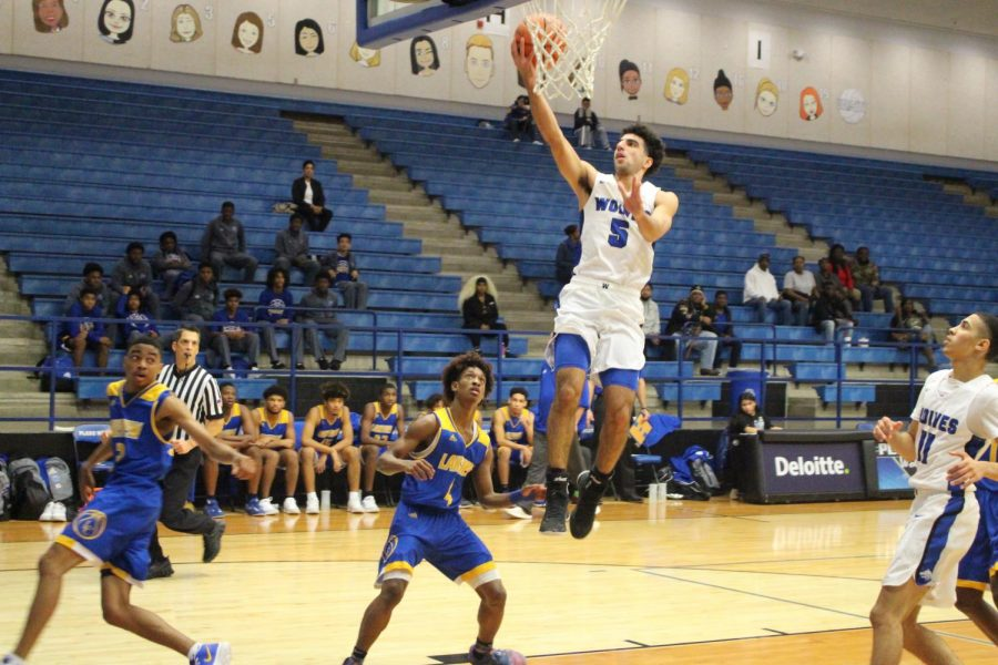 Senior guard Ryan Zambie (#5) puts in a layup for two points.