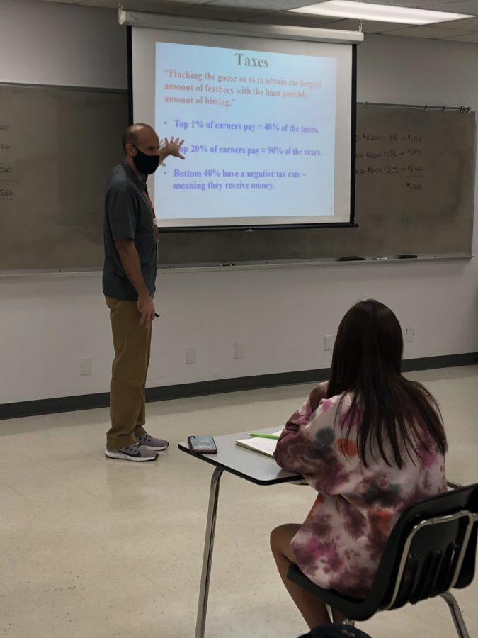 Collin economics professor Daniel Sattizahn explains regressive and progressive taxes to students on Wednesday, November 4.
